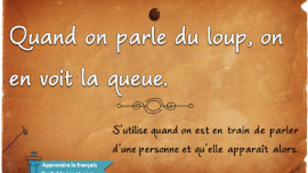 French expression: Quand on parle du loup, on en voit la queue